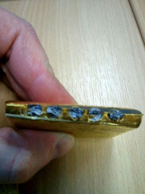 tungsten filled 1 kilo gold bar discovered in uk