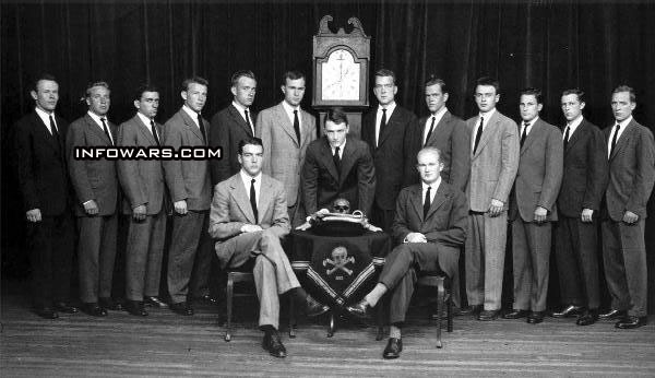 George h bush left of clock with the skull and crossbones group at